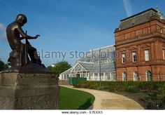 Peter Pan statue overlooking the Peoples' Palace and Winter Garden, Glasgow Green, Scotland - Stock Image
