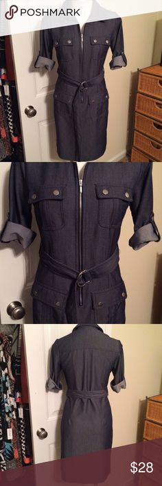 Denim shirt dress Short rolled sleeve, collar shirt style, belted, zip front, denim dress, w/pockets. About knee length. Light to medium weight denim. This dress is made with a dressier kind of denim. Great for work!!! Worn 1-2 times. In excellent condition! Dress Barn Dresses