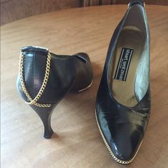 Stuart Weitzman Black Leather shoes w/Gold Chains Stuart Weitzman black leather pumps with gold chain detail. Good condition with few Knicks in leather, see photos. Check out the $6 section near the bottom of my closet (before the sold items) for lots of bundle-worthy $6 items! 15% bundle discount on 2+ items in a bundle. Stuart Weitzman Shoes Heels