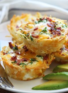 Shredded hash browns and cheese nests baked until crispy topped with a baked eggs, crumbled bacon and more cheese. Served with chilled avocado slices. #breakfast #brunch http://livedan330.com/2015/04/12/hash-brown-egg-nests-2/