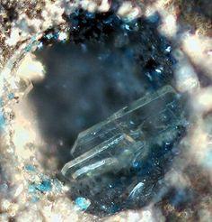 Matlockite, PbFCl, Charakas, Sounion, Lavrion, Attica, Greece. Tabular colorless crystals. Fov 0.9 mm. Collection: Lithothek der Münchener Micromounter. Copyright: Manfred Früchtl