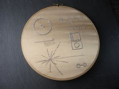 """Embroidery of the cover of """"The Sounds of Earth"""", the gold record included on the Voyager 1 and 2 probes. Shannon Henry 2012"""