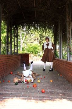 Chibitaria_4 -APH by ShikiTobari.deviantart.com on @deviantART - Little Feliciano and Lovino cosplay - Feli's the one who's just fallen with the whole basket of tomatoes, and Lovi doesn't look impressed.
