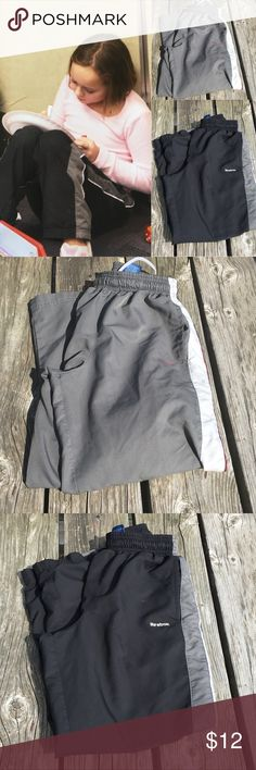 🆕List! Kids Warm-Up Pant Bundle! GUC! Two pair of fully lined warm-up pants by Reebok! Both pair were worn by both my daughter and son though I believe they are boys pants. They both show some wear to knees but no holes. One pair is black with gray side stipe. One pair is medium gray with light gray side stripe. Side pockets. Full mesh lining. Both are size small 8/10. Overall good condition with normal signs of wear. Can be sold separately if desired. Reebok Bottoms Sweatpants & Joggers