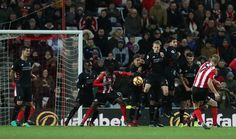 Sebastian Larsson of Sunderland (R) takes a freekick during the Premier League match between Sunderland and Liverpool at Stadium of Light on January 2, 2017 in Sunderland, England.