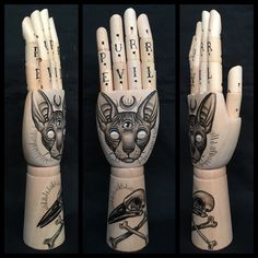 Large wooden hand mannequin with original drawing of a sphynx and bird skull 'tattoo style' door Inkspirednl op Etsy https://www.etsy.com/nl/listing/260504151/large-wooden-hand-mannequin-with