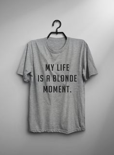 This My life is a blonde moment T-shirt design is printed on unisex casual fit t-shirt blended with cotton and polyester which give you an ultra-soft feel, breathable and lightweight garment. Fabric Color Black : High Quality 100% Cotton T-shirt Gray : 60% / 40% Cotton / Poly-Blended fabric White : 60% / 40% Cotton / Poly-Blended fabric Print Material Black: High Quality White Color textile heat transfer vinyl Gray with white text: High Quality White Color textile heat t...