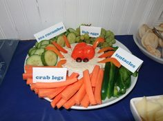 """our fish party: the kids loved reading out the new names for all the food. included """"shark teeth"""" on the bottom right (cheese cut into triangles)."""