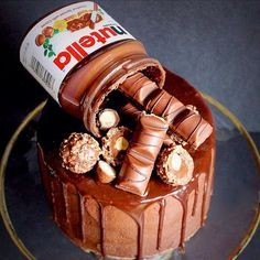 - Chocolate Nutella Sponge Cake with Chocolate Ganache and Assorted Chocolate Treats on Top!  TAG a Cake Lover! - Cake by: @goodiesbydani Source: @Meal