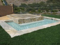 I really like the idea of the smaller pool but with the spa up top instead of the splash pad. lol.