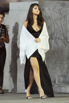 Another slip dress moment, this time paired with Giuseppe Zanotti strappy sandals. - HarpersBAZAAR.com