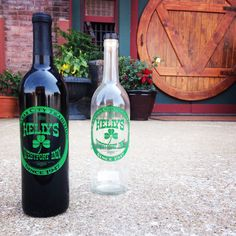 Custom etched wine and serving bottles for one of the oldest bars in Kansas City - we can incorporate any skyline or logo onto a bottle! #custom #wine #gifts #kansascity