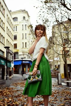 chic clutch with green skirt and white top
