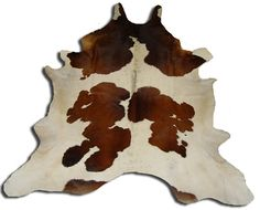 cow hide rug. Nothing says floor acoutrement like some tanned hide.