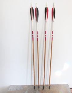vintage wooden arrows / black and red arrows. $56.00, via Etsy.