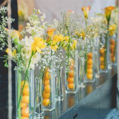 Simple and cute...lemons and day lillies with a touch of baby's breath.  Economical centerpiece.