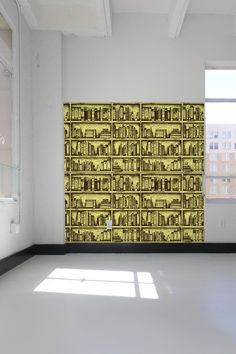 Bookshelf wall tiles—for the one remaining section of your wall that doesn't contain a real bookshelf.