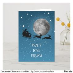 This beautiful drum card features Santa with his sleigh packed with a drum kit, with wishes of peace, love and drums! Perfect for musicians, music lovers and drum enthusiasts. Copyright 2019 and ONLY available from DrumJunkie. Did you know? All our drum-themed merch is designed by a drummer! #drummerchristmas #drummersanta #drumsticks #drumjunkie