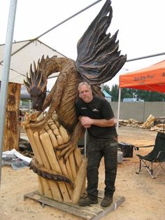 Amazing Chainsaw created dragon  ❤ ❤ http://www.chainsawking.com/photos/ — with Arkadius Rusnica, Alan Moore, Joshua Mueller and Lambert Lucy.