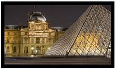 Paris, France.    The Pyramide du Louvre (Louvre Pyramid) is located in the courtyard of the famous Musee du Louvre (Louvre Museum). The pyramid is constructed of glass, cable and steel rods. The glass and steel pyramid is a very modern interpretation of an ancient form and provides for a interesting contrast with the much more traditional buildings situated around it.     Available for purchase @  http://www.etsy.com/shop/bokehnyc