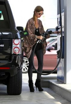 Nicky Hilton fills up her black Range Rover. Compared to her sister, it looks like Nicky has a far smaller car collection.
