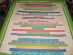 Jelly Roll Lap Quilt in bright pastels by TheRetiredQuilt on Etsy, $225.00
