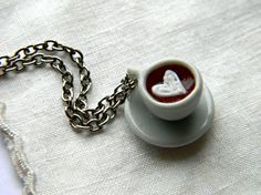 Super Cute Coffee Cup with a Swirly Heart Necklace Made to Order. $15.00, via Etsy.