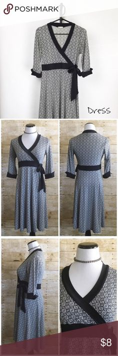 "Maurice's black and white wrap dress size medium Soft and stretchy. In good used condition with slight fading. 37"" Long 15"" waist 15"" bust measurements are approximate size medium Maurices Dresses"