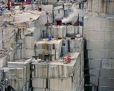 Edward Burtynsky - creates mind blowing images of manufactured landscapes...