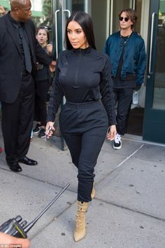 Don't sweat it! Kim Kardashian was spotted looking stylish and sporty in a black tracksuit top and sweatpants in New York on Monday