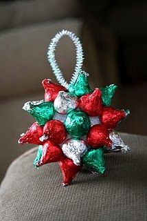 "A ""Kisstletoe"" made out of Hershey Kisses, styrofoam ball, & pipe cleaner (or ribbon) Use glue gun to assemble."