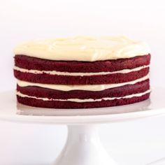 The ultimate red velvet cake covered in a whipped vanilla buttercream frosting - moist, decadent, utterly delightful!