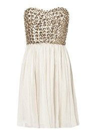 Danae dress by Rachel Gilbert. (This picture kind of sets you up for disappointment. Its actually nude and gold and long.) Still a nice dress though, but not to party in for $500.