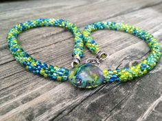 Kumihimo Beaded Necklace with Lampwork Focal Bead. $39.00, via Etsy.