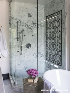 Add interest to your shower with an inset tile mural.