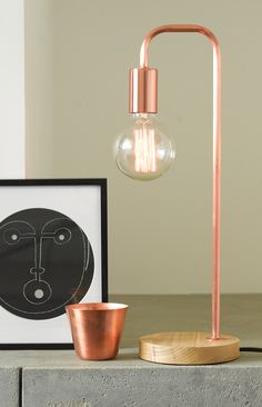 Lanie 1 light modern table lamp in copper with ashwood base.