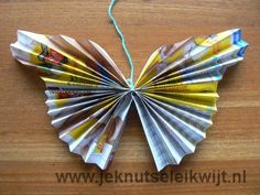 You can make this pretty folded butterfly using folded up pages from an old magazine. Read the article to find out how to make this pretty butterfly Butterfly Shape, Butterfly Crafts, Butterfly Wings, Summer Crafts, Crafts For Kids, Magazine Crafts, Old Magazines, Folded Up, Beautiful Butterflies