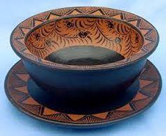 Wooden bowl and plate with black batik design