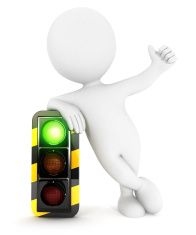 3d white people traffic light on green stock photo