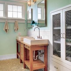 Decorative grilles punch up plain cabinet doors in this bathroom cabinet and help obscure towels and  toiletries while allowing air to circulate. | Frank L. Jenkins/Vista Estate Imaging | thisoldhouse.com