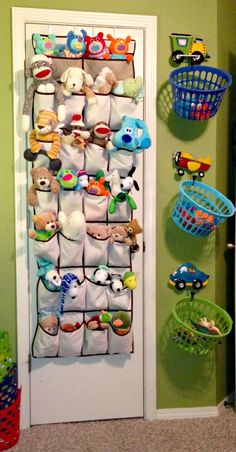 Stuffed Animal Idea ~ Stuffed animals in shoe organizers and hang baskets for toys from cute coat hangers.