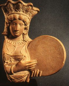 Cybele- she's holding a drum, not a cake like some archeologists like to say.