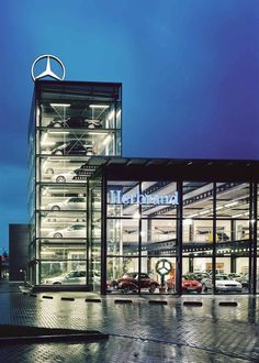 CAR DISPLAY TOWER - Designer Fully automatic parking systems from Wöhr ✓ all information ✓ high-resolution images ✓ CADs ✓ catalogues ✓ contact. Architecture Site Plan, Factory Architecture, Cinema Architecture, Retail Facade, Showroom Interior Design, Los Angeles Restaurants, Street Bob, Garage Design, Monster Energy
