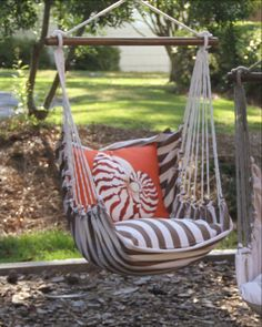 """Go get your book, it's swing time! Our swing chair is so cozy, complete with bottom solid Latte pillow and back Shell pillow. 4-Piece set includes Hammock Swing, 22"""" bottom pillow, Nautilus back pillow and a matching bag hammock swing to hold it all together. Choose from three colorations to go with the shell pillow, either the Chocolate Stripe coordinate, Chocolate Solid or the lighter Latte Solid coordinate. All you need is a covered dock or big 'ole tree(and maybe a book). Perfect even…"""