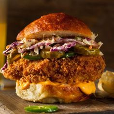Chick-fil-A's spicy chicken deluxe sandwich never fails to impress. We were so inspired by the crispy deliciousness of the sandwich that we made our own. Check out this awesome recipe for copycat Chick-fil-A spicy chicken deluxe sandwich. Popeyes Chicken Sandwich Recipe, Spicy Chicken Sandwiches, Spicy Chicken Recipes, Fried Chicken Sandwich, Breaded Chicken, Chick Fil A Spicy Chicken Recipe, Chicken Tenders, Vegan Sandwiches, Crispy Chicken Burgers