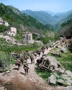 African American Soldiers of the US 92nd Infantry (Buffalo) Division pursue the retreating Germans through Massa Carrara, Italy, end of April-1945.