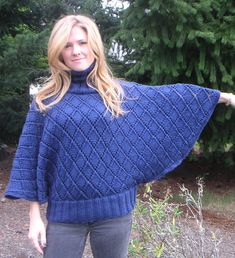 Free Knitting Pattern for Wallis Poncho - Pullover poncho / sweater hybrid with dolman sleeves and ribbed hem in a diamond lace pattern. Sizes XS, S, M, L, XL Designed by Sarah Hatton. Aran weight. Pictured project by BunnyWahl