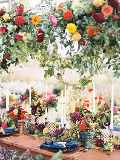 Stunning and Colorful Wedding Tablescape - Lauren Gabrielle Photography | Planning + Design: A Charming Fête | Local Flowers: Berry's Blooms | Floral Design: Molly Taylor + Co. | Vintage Rentals: Borrow Rentals | Chargers, Napkins + Champagne Glasses: Event Source