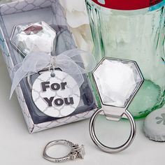 Perfect as favors for engagement parties and bridal showers, these sparkling and useful bottle openers are destined for favor greatness.