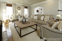 absolutely love this room, colors, decor, rugs and coffee table!!!